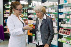 pharmacist assisting elderly woman
